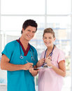 Young Nurse and Doctor smiling at camera Stock Photos