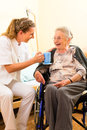 Young nurse and female senior in nursing home Royalty Free Stock Photography