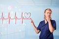 Young nurse listening to abstract pulse with red heart beautiful Stock Photos