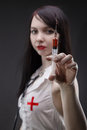 Young nurse with syringe and red liquid Royalty Free Stock Photo