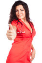 Young nurse or woman doctor with thumb up Royalty Free Stock Images