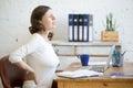 Young office woman feeling backache