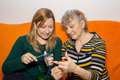 Young and old females knitting together Stock Photos