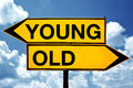 Young or old opposite signs two against blue sky background Royalty Free Stock Photography