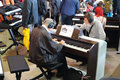 Young and old people playing the keyboards with headphones moscow sep on xviii international exhibition of music moscow in Royalty Free Stock Image