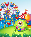 A young one eyed monster holding a balloon near the carnival illustration of Royalty Free Stock Photo
