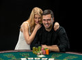 Young сouple playing poker have a good time in casino