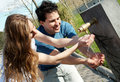 Young pair near a drinking fountain with water Royalty Free Stock Photo
