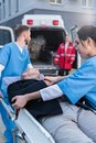 young paramedics moving wounded man Royalty Free Stock Photo