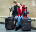 Young passengers with luggage waiting for train at subway statio Royalty Free Stock Photo