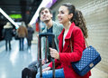 Young passengers with luggage waiting for train Royalty Free Stock Photo