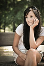 Young pensive woman siting on bench Royalty Free Stock Photography