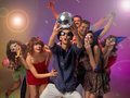 Young people amazed by a disco ball Royalty Free Stock Photos