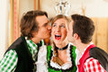 Young people in Bavarian Tracht in restaurant Stock Images