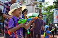 Young people celebrating songkran thai new year water festival chiang mai thailand april in the streets by throwing at each Royalty Free Stock Photo