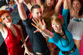 Young people dancing in club or disco men and women the girls boys having fun Stock Photo