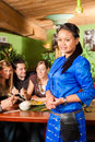 Young people eating in Thai restaurant Royalty Free Stock Image