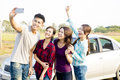 Young  people enjoying road trip  and making selfie Royalty Free Stock Photo