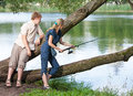 Young people on fishing portrait in a sunny day Stock Image