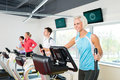 Young people on fitness treadmill running exercise Stock Photography