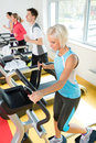 Young people on fitness treadmill running exercise Royalty Free Stock Photo