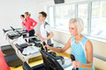 Young people on fitness treadmill running exercise Royalty Free Stock Images