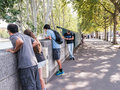 Young people gaze over stone wall to seine river in paris france august look toward on summer morning Stock Photography