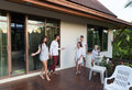 Young People Group On Terrace Tropical Hotel, Friends Tropic Holiday Vacation Royalty Free Stock Photo