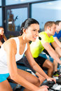Young people group women men doing sport spinning gym fitness Royalty Free Stock Photos