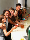 Young people having drinks at a bar Stock Photo