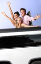 Young people having fun in limousine Stock Image