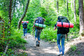 Young People Hiking With Backp...