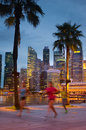 Young people jogging in night city singapore life downtown Stock Photo