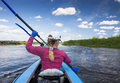 Young people are kayaking on a river in beautiful nature. Summer sunny day Royalty Free Stock Photo