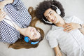 Young people listening music Royalty Free Stock Photo