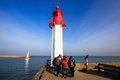 Young people look at the map of the lighthouse in the city of De Royalty Free Stock Photo