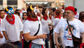 Young people in masks having fun at of San Fermin Royalty Free Stock Images