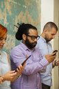 Young people with mobile phones in hands Royalty Free Stock Photo