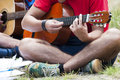 Young people playing guitar together Royalty Free Stock Photos