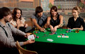 Young people playing poker. Stock Photos