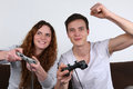 Young people playing video games Royalty Free Stock Photo