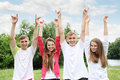 Young people raised their hands on nature Stock Photo