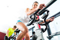 Young People Spinning in the fitness gym Royalty Free Stock Photo