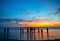Young people at sunset beach in Kuta, Bali Royalty Free Stock Photo