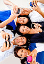 Young people texting on phones Royalty Free Stock Images