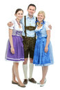 Young people in traditional bavarian tracht group of isolated on white Stock Photo