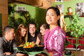 Young people with waitress eating Thai Royalty Free Stock Photos