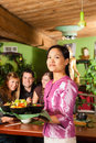 Young people with waitress eating Thai Stock Photo