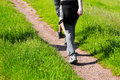 Young people walking along a rural farm track Royalty Free Stock Photo