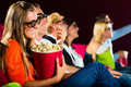 Young people watching 3d movie at cinema Royalty Free Stock Photography